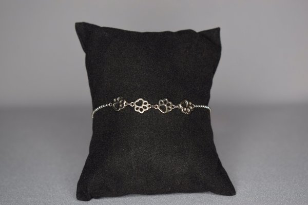 Sterling silver bracelet with 4 dog paws